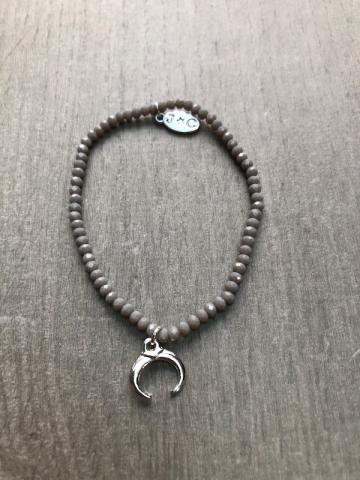grey beaded bracelet with half moon symbol