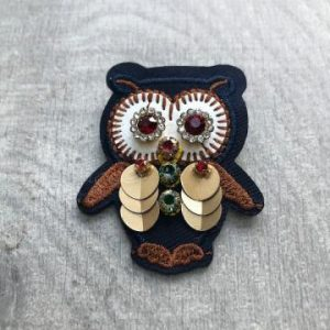 Gold winged owl